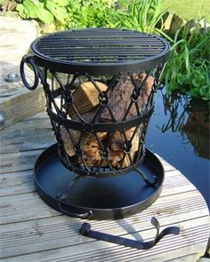 Wrought iron fire brazier- base needed so as not to burn decking