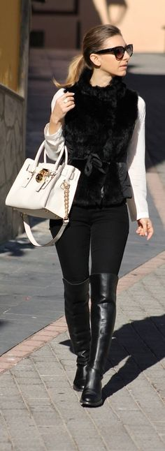 Winter Look: Classic black faux fur vest with fitted pant and boot