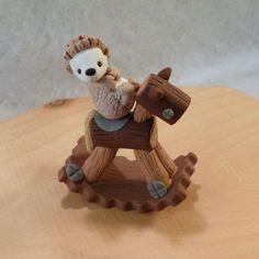 adorable hedgehog and rocking horse.
