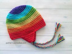 Easy Ear Flap Hat In an effort to use up some of the scraps in my stash, I decided to use this lovely Red Heart Soft yarn in a rainbow of colors to make an earflap hat.  ~ Don't lose it, add It To Your Ravelry Queue Or Favorites ~ ~ And don't forget to …