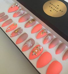 Nude to neon summer design decorated with real Swarovski crystals & gold accents. Stiletto shaped press on nails. Set includes 20 nails size 0 to