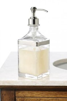 Alhambra Lotion Dispenser  A clear glass dispenser is most elegant.  #HomeDecorators