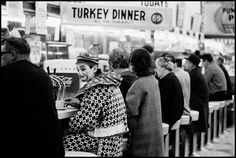 Thomas Hoepker, 1963,  Clown at a diner on Thanksgiving in Reno, Nevada.