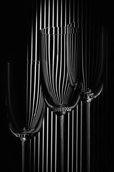 Glasses in pinstripe suit by Erhard Batzdorf