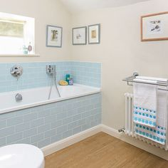 Traditional bathroom with blue tiling and vinyl flooring