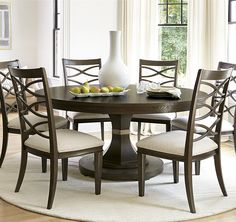 """this Dining Room collection can be as crisply tailored as dinner in Beverly Hills or as unbuttoned as a Malibu sunset supper. Crafted of rustic white oak veneers and oak solid woods, the California Rustic Oak Extending Dining Table offers two distinctive finishes: the darker Hollywood Hills finish and the lighter Malibu finish. This round extension dining table feature fancy coved apron, pedestal base and one 16"""" leave that extend the round extension dining table to 80 inches."""