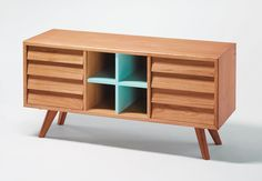 Wooden sideboard with blue accents and drawers inspired by Scandinavian sailboats