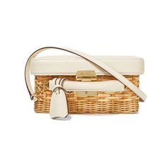 """- """"With plans to escape the sweltering NYC heat in favor of breezier California temps, I'm loving this rattan shoulder bag by Mark Cross—the boxy silhouette and contrasting materials are polished yet suited to many a summer activity.""""—Laura Lajiness, New York Editor"""