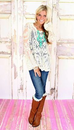 I just bought this adorable top today! :-)  Cream Lace top with the jeans and boots! Lacehttp://aguidetowhatsinsideyourbeautybag.blogspot.com/
