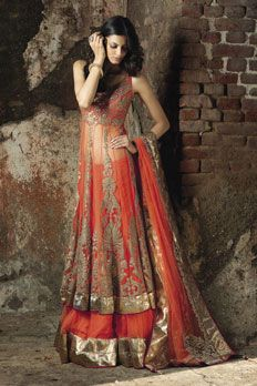Net ghagra, with long jacket, embellished with patch work, along with sequins and stone along with net dupatta.