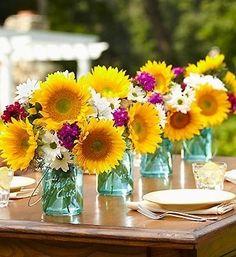 Sunflowers & daisies in aqua vases