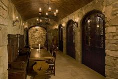 Stone walls. Lighting. Vaulted ceiling. Glass & wood doors to cellar.... barrel vault.