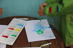 Use a medicine dropper and watered down paints on cardstock for a fun painting.