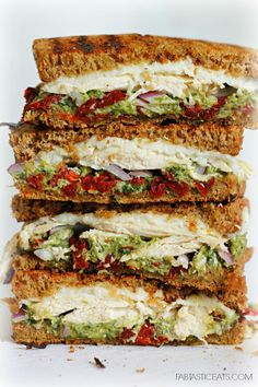 Stack up some good eatin'! This chicken, sun-dried tomato, and asparagus pesto sandwich is a tall order of yum!