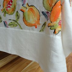 Linen Pomegranate Table Cloth with Mitered Border available online at www.carolenevin.com