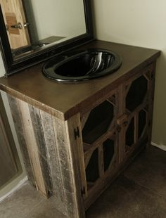 Mens bathroom vanity made from barnwood cabinet with a concrete top that was made then I acid stained and finished with concrete sealer.