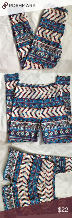 LuLaRoe aztec Print Leggings! LuLaRoe aztec print leggings! One size! I love this print would look great with a denim top or anything actually! White, blue, maroon and tan colors! Gently used condition! only sign on wear is the inside of legs at the top! I showed a picture! Very minor and can not be seen! Comfortable!! LuLaRoe Pants Leggings
