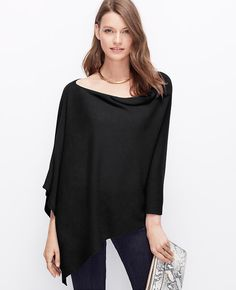 """Rendered in luxuriously soft cashmere, this versatile style flaunts a flattering-for-all poncho silhouette that layers beautifully. 21 1/2"""" long."""