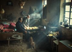 """Two brothers live in a traditional yaodong, or """"kiln cave,"""" carved into a hillside on the Loess Plateau in central China. The earth-lined walls have good insulation, enabling residents to survive cold winters. Li Huaifeng/World Press Photo World Press Photo, Best Insulation, Photo Awards, Two Brothers, Old Paintings, China, Photojournalism, Photo Contest, Persona"""