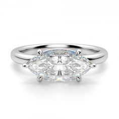 The beauty of a solitaire takes a new direction. A Contemporary Nexus Diamond™…