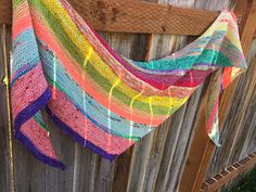 Mini skeins! They are just about my favorite thing! But there are only so many socks and blankets that one can knit. After staring at my luscious stash of bright, spring colors I created this delectable shawl. It's such a simple and addicting knit, with color changes happening however you desire. It's like painting with your yarn!