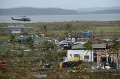 A general shot shows fallen trees and destroyed houses in the aftermath of Super Typhoon Haiyan in Tacloban, eastern island of Leyte on November 9, 2013. One of the strongest typhoons on record killed more than 100 people as savage winds and giant waves flattened communities across the Philippines, authorities said on November 9 while corpses lay amid the devastation.