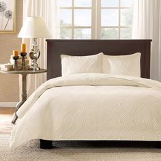 @Overstock - Madison Park Adelle 3-piece Coverlet Set - This coverlet set comes in beautiful white or ivory and includes two matching shams. With a microfiber polyester face, the coverlet is soft to the touch and machine washable for easy care.  http://www.overstock.com/Bedding-Bath/Madison-Park-Adelle-3-piece-Coverlet-Set/8899880/product.html?CID=214117 $75.99