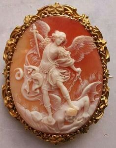 Cameo of Cornelian Shell, gold, Italy, circa Based on Baroque-style painting from 1635 by painter, Guido Reni depicting St. Michael the Archangel slaying the devil by caroline. Victorian Jewelry, Antique Jewelry, Vintage Jewelry, Silver Jewellery, Jewellery 2017, Cartier Jewelry, Antique Rings, Fine Jewelry, St. Michael