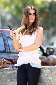 Kate Beckinsale Lookbook: Kate Beckinsale wearing Clogs (2 of 13). Kate paired her skinny jeans with a cool pair of brown clogs.
