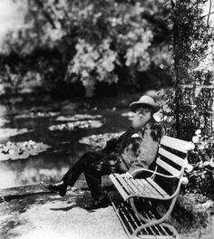 Monet sitting next to the waterlily pond in his garden at Giverny in France