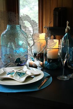 Summer beach table with starfish, seaglass and sea fan.