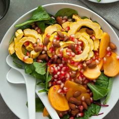 A cool-weather salad filled with roasted delicata squash, persimmons and pomegranate that's brimming with bright  flavors and colors.