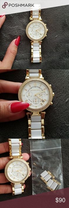 Michael kors watch almost New Worn 1 time. It has been adjusted but still have the extra training links so u can always resize it. I can't find the box Almost new condition still have the  plastic on back Color white/gold Michael Kors Accessories Watches