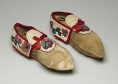 Hmmm Comment:  I am thinking these are Northeastern Woodland pointy moccasins with the collar, but semi geometric flat florals -- so somewhere in the Great Lakes region.