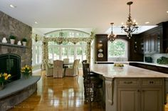Contrasting cabinets, fireplace, chandeliers