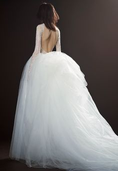 THÉRÈSE is a light ivory silk faille strapless A-line wedding gown with fringed silk organza flange technique accented by beaded crystal and pearl buildup and hand knotted ribbon by Vera Wang.