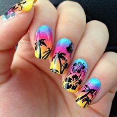 Neon and black nails look absolutely stunning! The palm trees and hibiscus flowers look cute on the neon colors.