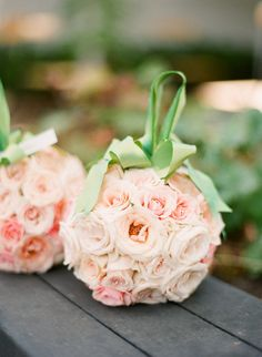 itty bitty rose pomanders carried by the flower girls  Photography by http://lisalefkowitz.com,Floral Design by http://kristiamoroso.com