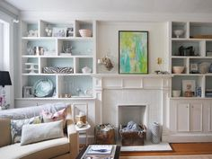 really pretty built in bookcases surrounding mantle. Love the all white with light blue painted inside shelves on back. | HGTV