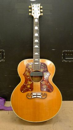 Ronnie Wood's 1950's Gibson J200. Double pick guards make this a very unique guitar, albeit different from the official Gibson Ronnie Wood model.