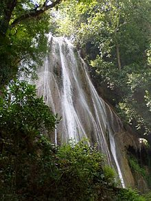 """Cola de Caballo (Spanish for """"Horse Tail"""") is a waterfall about 40 km (25 mi) from Monterrey, Mexico, in the town of Villa de Santiago, Nuevo León. It is open to the public and is accessible via a walking path."""