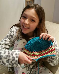 My daughter making her first crochet hat on her own with little advice from me. So proud of her.   #crochet #yarn #wool #handmade #handcrafts #hat #beanie #diy #allcrochet #simplycrochet #loveit #love #fun #hooked #slouchybeanie #turquoise #green #coral #red #girly #crochetaddict #accessories #instacrochet #instagood #instalove #instafun #instalike #wailingart by wailing.art