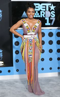South African star Nomzamo Mbatha was gorgeous in a traditional pattern dress with a form0fitting silhouette. REUTERS/Danny Moloshok via @AOL_Lifestyle Read more: https://www.aol.com/article/entertainment/2017/06/25/bet-awards-2017-red-carpet-arrivals/23000929/?a_dgi=aolshare_pinterest#fullscreen