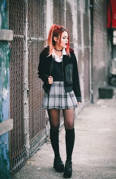 Le Happy wearing Sandro jacket and plaid skirt
