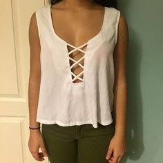 Crisscrossed sexy top Sexy crisscrossed top and back! Never been worn Tobi Tops Blouses