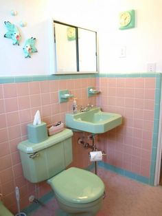 Kristen and Paul's mid-century modest Florida getaway - Kristen and Paul recently bought a winter home in Florida and re-decorated with their own colorful, mix-it-up, affordable, retro style. Pink Bathroom Tiles, Pink Tiles, Vintage Bathrooms, Small Bathroom, Bathroom Photos, Pink Bathrooms, Art Deco Bathroom, Modern Bathroom, Retro Renovation