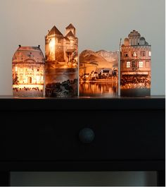 DIY HOUSES...Cut our houses from old magazines use scotch tape to fasten sides together, place over battery operated tealight candles