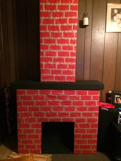 I made this for a Christmas display this past Christmas from cardboard milk boxes.  Cardboard fireplace. Homemade fireplace. Crafts. Classroom for the holidays. Teachers. School decorations. Holiday decor. Holiday decorations. Christmas decorations.