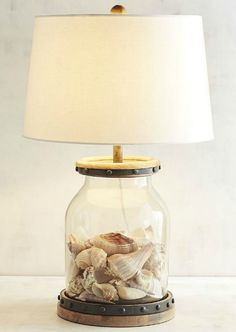 Chic Fillable Table Lamp... http://www.beachblissdesigns.com/2017/04/neutral-beach-living-room-easy-sectional.html Put your beach shells on display with a gorgeous lamp!