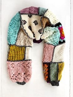 Turn youe knit and crochet swatches into a story-telling shrug!